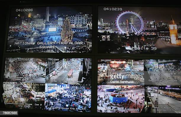 Television monitors displaying images captured by a fraction of London's CCTV camera network within the Metropolitan Police's Special Operations Room...
