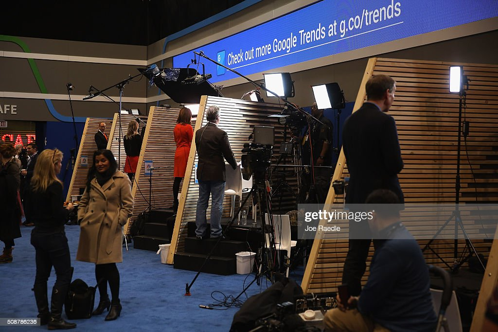 Television network reporters work from inside miniature studios set up in wood-walled stalls in the media filing center for the Republican presidential debate at St. Anselm College February 6, 2016 in Manchester, Iowa. Sponsored by ABC News, the Independent Journal Review and Google, this is the final televised debate before voters go to the polls in the 'First in the Nation' New Hampshire primary.