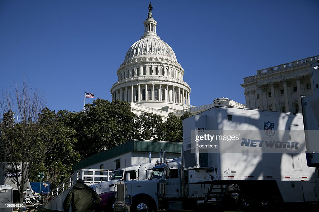Television network trailers sit outside the U.S. Capitol prior to the second inauguration of U.S. President Barack Obama in Washington, D.C., U.S., on Friday, Jan. 18, 2013. President Obama's second inauguration next week will combine the star power of Beyonce, Kelly Clarkson and James Taylor with a lineup that reflects social values Obama will champion in his new term. Photographer: Andrew Harrer/Bloomberg via Getty Images