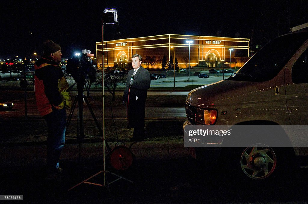 A television news anchor does a broadcast outside Westroad Mall 05 December 2007 in Omaha Nebraska where man armed with a semiautomatic rifle opened...