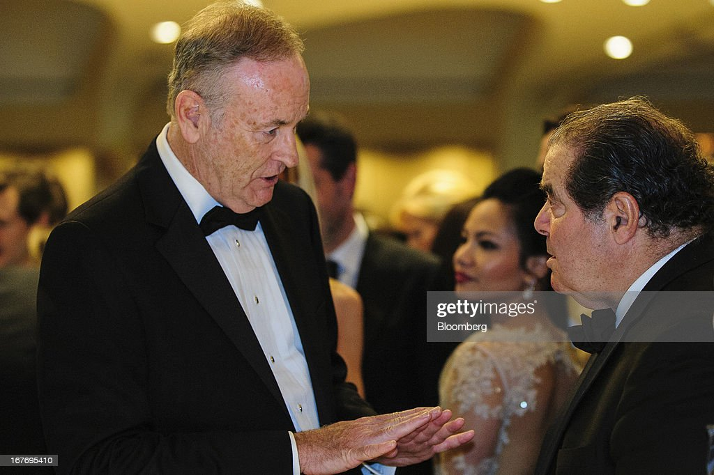 Television news commentator Bill O'Reilly, left, talks with U.S. Supreme Court Justice Antonin Scalia during the White House Correspondents' Association (WHCA) dinner in Washington, District of Columbia, U.S., on Saturday, April 27, 2013. The 99th annual dinner raises money for WHCA scholarships and honors the recipients of the organization's journalism awards. Photographer: Pete Marovich/Bloomberg via Getty Images