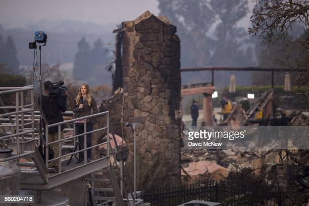 Television news crews report from the site of the familyowned winery Signorello Estate on Napa's Silverado Trail which was destroyed by the Atlas...