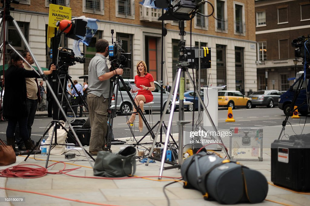 A television news presenter (C) broadcasts from outside the BP headquarters in central London, on July 27, 2010. BP said Tuesday it suffered a loss of 16.9 billion dollars in the second quarter in the wake of the devastating Gulf of Mexico oil spill, which is forecast to cost the company 32.2 billion dollars. The group added in a statement that it will sell 30 billion dollars of assets over the next 18 months, as it streamlines the business, while under-fire boss Tony Hayward will be replaced by Bob Dudley in October.