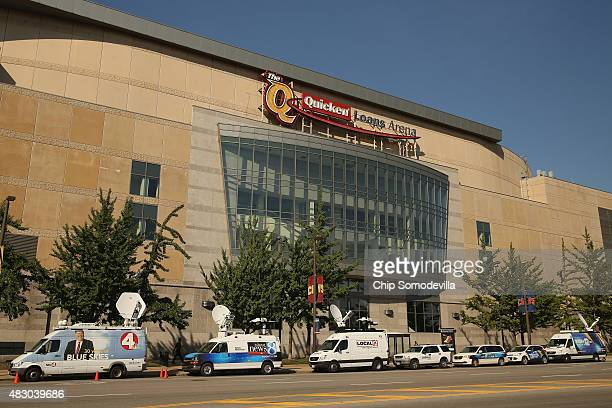 Television news satellite trucks are parked in a row outside the Quicken Loans Arena on the eve of the first Republican presidential debate August 5...