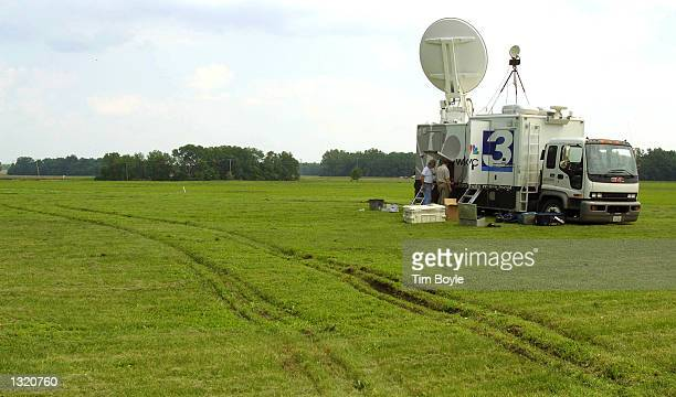 A television news truck is set up in a field June 9 2001 near the grounds of the US Federal Prison in Terre Haute Indiana Convicted Oklahoma City...