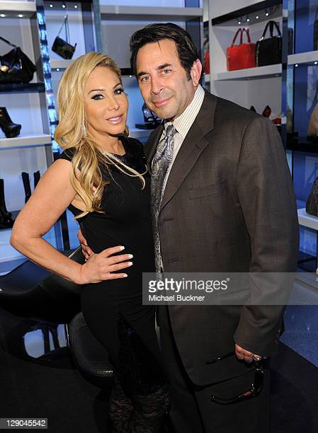 Television personalities Adrienne MaloofNassif and Dr Paul Nassif attend the Versace Dinner hosted by Christine Chiu Galina Sobolev and Harper Bazaar...