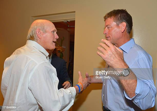 Television personalities and former National Football League players Terry Bradshaw and Troy Aikman appear backstage at the 'Terry Bradshaw America's...