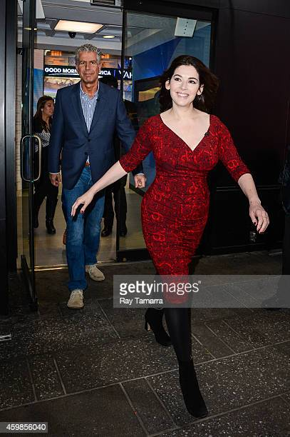 Television personalities Anthony Bourdain and Nigella Lawson enter the 'Good Morning America' taping at the ABC Times Square Studios on December 2...