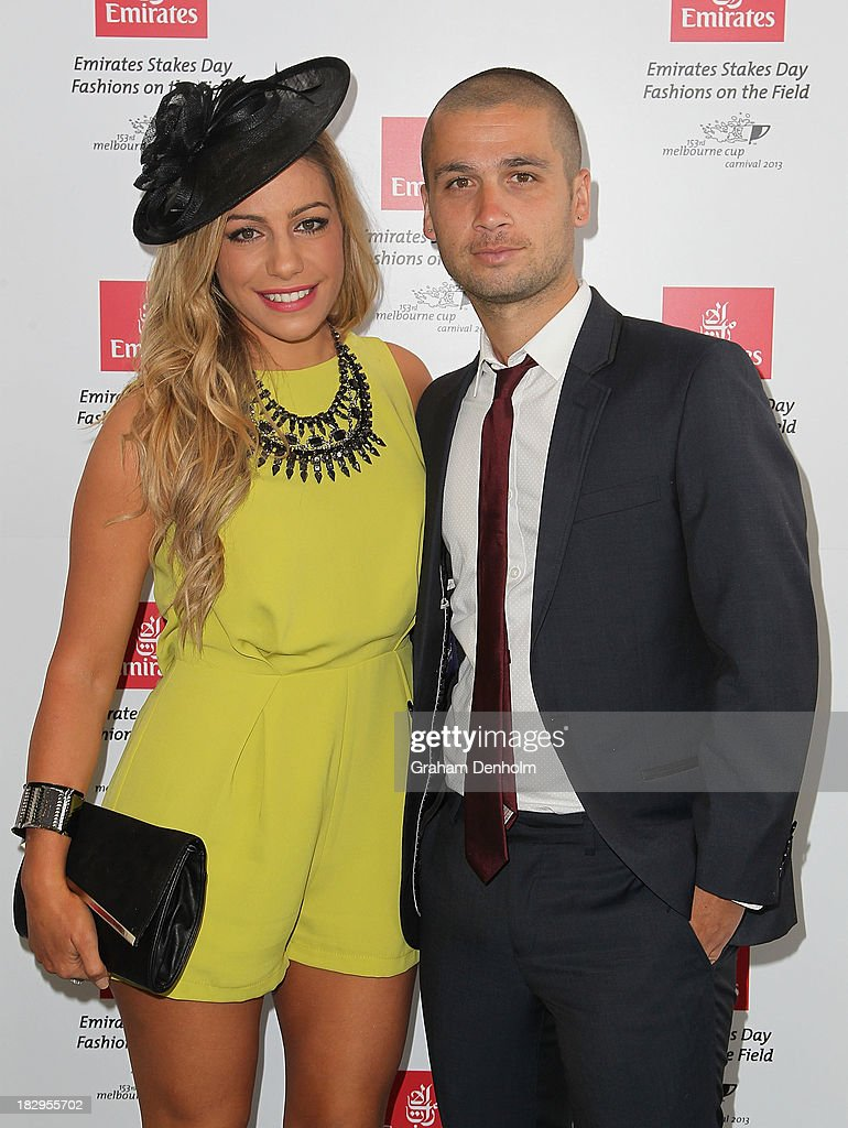 Television personalities Bec Douros and George Douros pose at the Emirates Stakes Day Fashion on the Field Launch at Flemington Racecourse on October 3, 2013 in Melbourne, Australia.