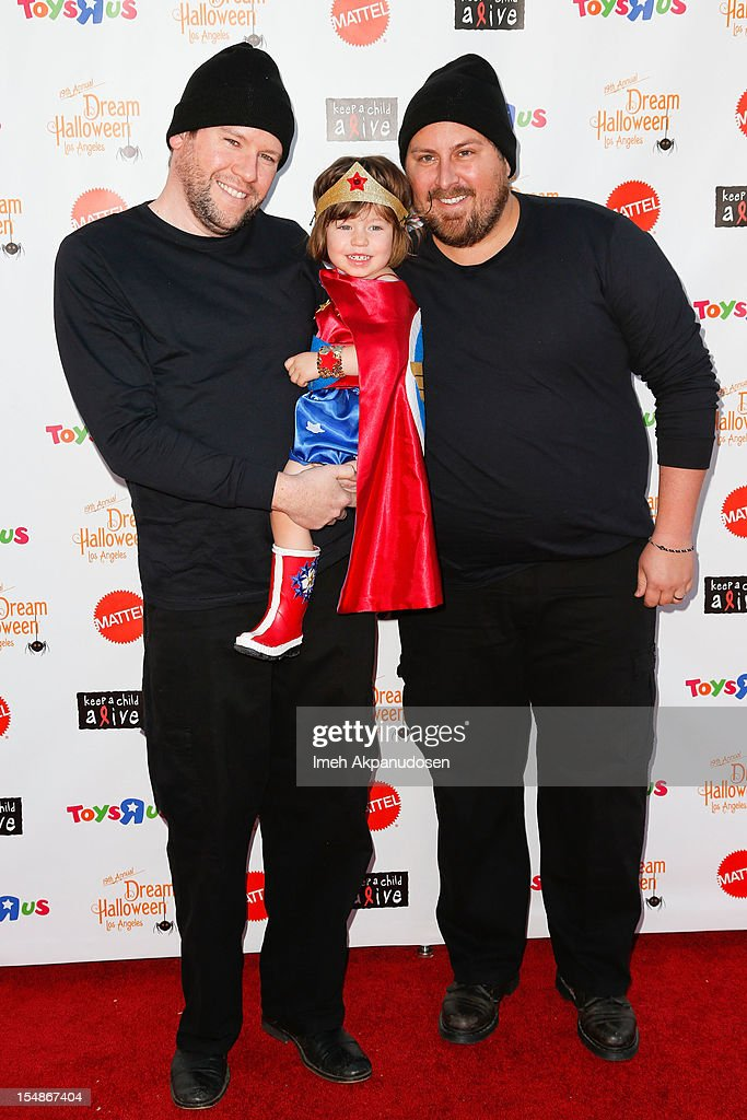 Television personalities Bill Horn, Simone Masterson-Horn, and Scout Masterson attend the 2012 'Dream Halloween' presented by Keep A Child Alive at Barker Hangar on October 27, 2012 in Santa Monica, California.