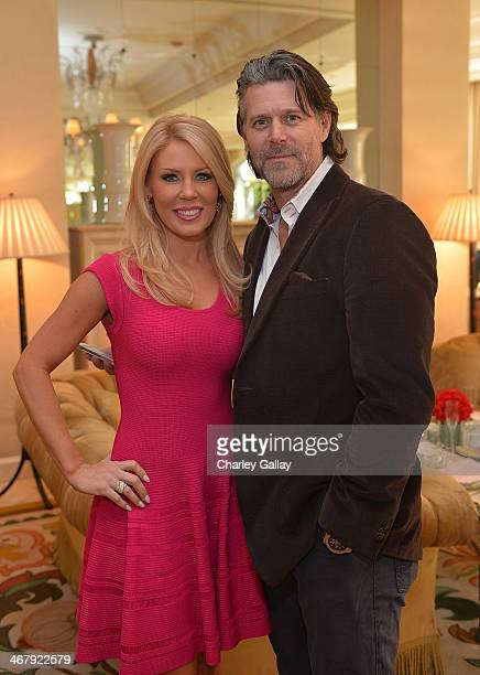 Television personalities Gretchen Rossi and Slade Smiley attend the Azadeh Launch Party And Fashion Show at Peninsula Hotel on February 8 2014 in...