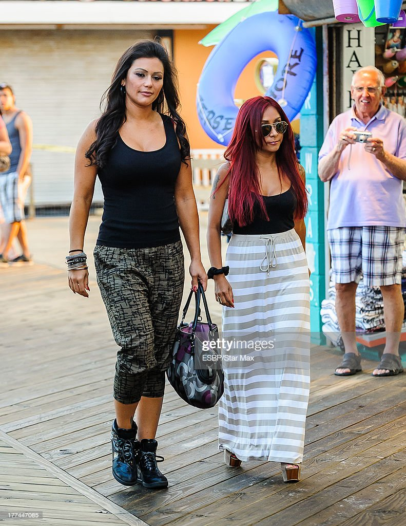 Television personalities Jenni 'JWOWW' Farley and Nicole 'Snooki' Polizzi are seen on August 22, 2013 in Seaside Heights, New Jersey.