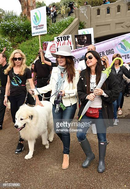 Television personalities Kathryn Edwards Lisa Vanderpump and Kyle Richards attend the StopYulinForever March to End Dog Cruelty in Yulin China at...