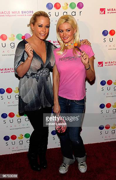 Television personalities Kendra Wilkinson Baskett and Holly Madison arrive for the grand opening of the Sugar Factory inside the Miracle Mile Shops...