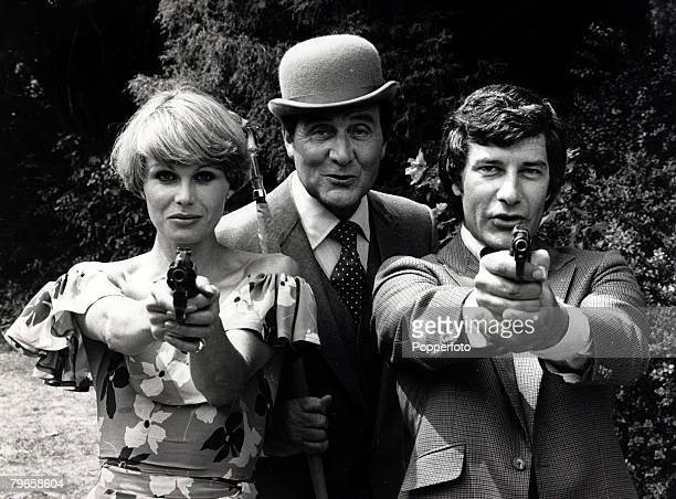 12th July 1976 The stars of the hit TV series 'The Avengers' lr Joanne Lumley Patrick Macnee and Gareth Hunt pictured posing at Pinewood Studios
