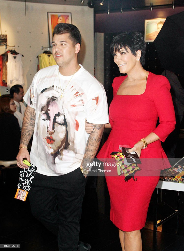 Television personalities Rob Kardashian and mom <a gi-track='captionPersonalityLinkClicked' href=/galleries/search?phrase=Kris+Jenner&family=editorial&specificpeople=762610 ng-click='$event.stopPropagation()'>Kris Jenner</a> make an appearance at the Kardashian Khaos store at The Mirage on March 16, 2013 in Las Vegas, Nevada.