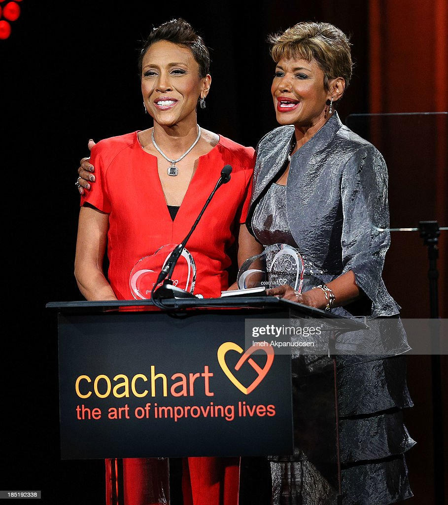 Television personalities <a gi-track='captionPersonalityLinkClicked' href=/galleries/search?phrase=Robin+Roberts+-+Television+Anchor&family=editorial&specificpeople=4439371 ng-click='$event.stopPropagation()'>Robin Roberts</a> (L) and Sally-Ann Roberts speak onstage during CoachArt's 9th Annual 'Gala Of Champions' at The Beverly Hilton Hotel on October 17, 2013 in Beverly Hills, California.