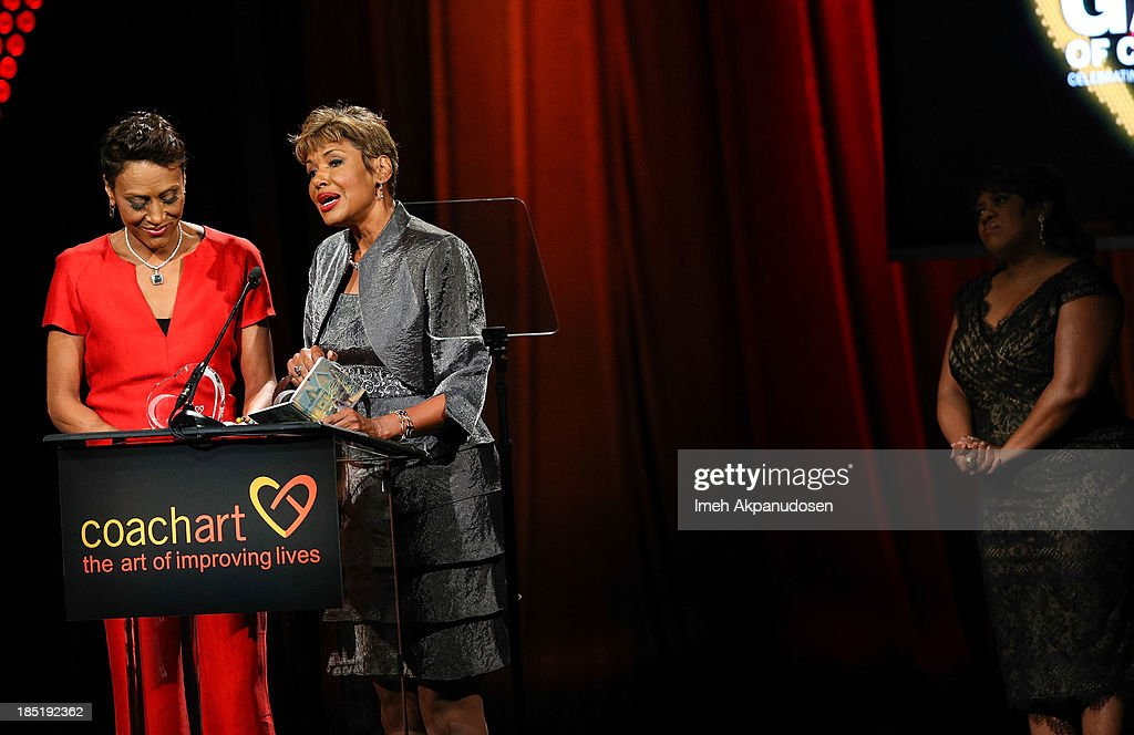 Television personalities Robin Roberts (L) and Sally-Ann Roberts speak onstage during CoachArt's 9th Annual 'Gala Of Champions' at The Beverly Hilton Hotel on October 17, 2013 in Beverly Hills, California.