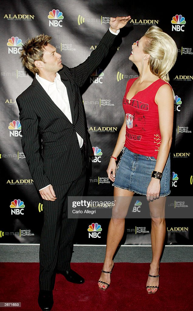 Television personalities Ryan Seacrest and Brooke Burns attend The 2003 Radio Music Awards at the Aladdin Casino Resort October 27, 2003 in Las Vegas, Neveda.