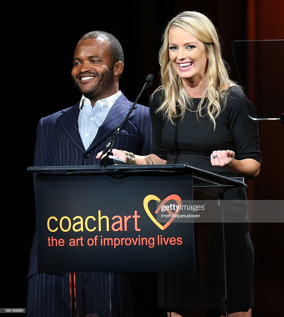 Television personalities Sal Masekela (L) and Brooke Anderson speak onstage during CoachArt's 9th Annual 'Gala Of Champions' at The Beverly Hilton Hotel on October 17, 2013 in Beverly Hills, California.