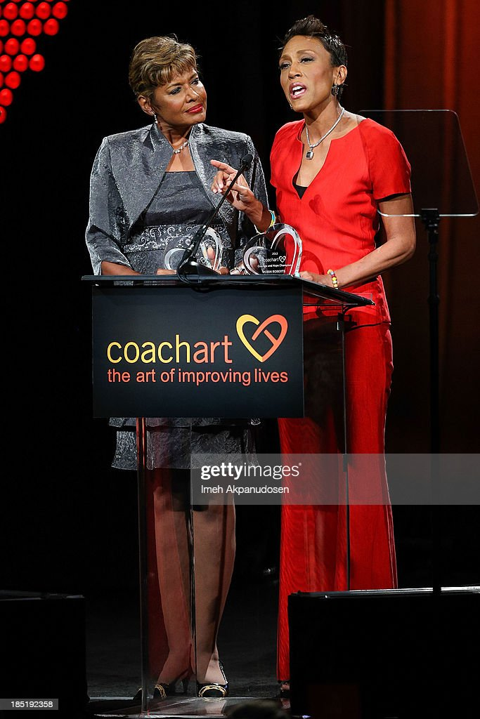 Television personalities Sally-Ann Roberts (L) and Robin Roberts speak onstage during CoachArt's 9th Annual 'Gala Of Champions' at The Beverly Hilton Hotel on October 17, 2013 in Beverly Hills, California.