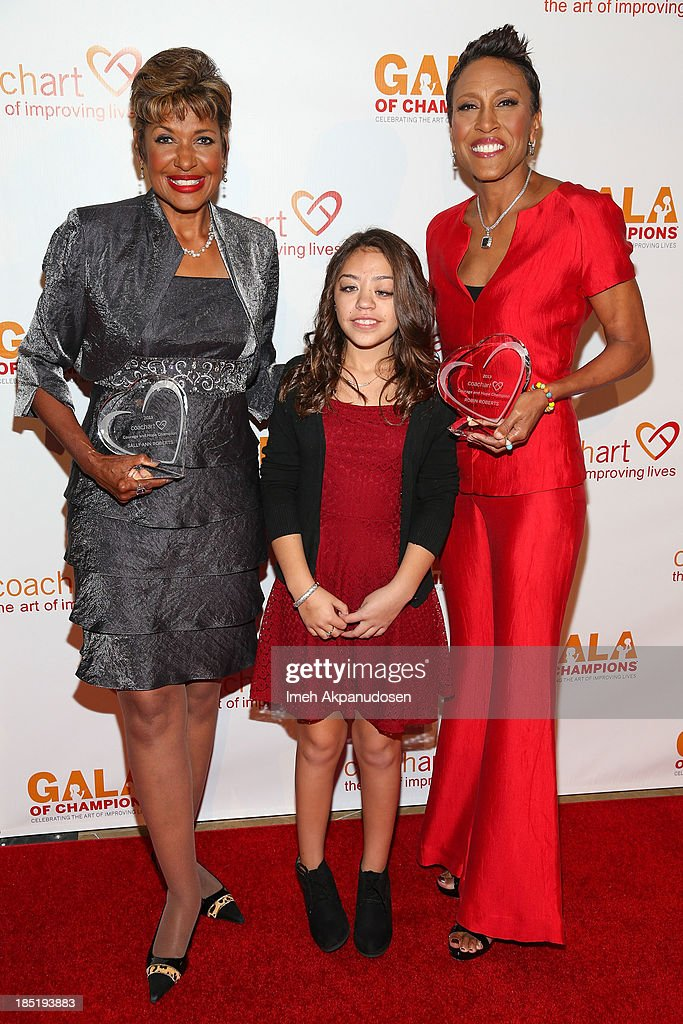 Television personalities Sally-Ann Roberts (L) and Robin Roberts (R) with Valerie Mendez attend CoachArt's 9th Annual 'Gala Of Champions' at The Beverly Hilton Hotel on October 17, 2013 in Beverly Hills, California.