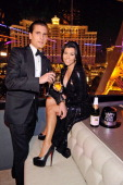 Television personalities Scott Disick and Kourtney Kardashian celebrate New Year's Eve at the Chateau Nightclub Gardens at the Paris Las Vegas on...