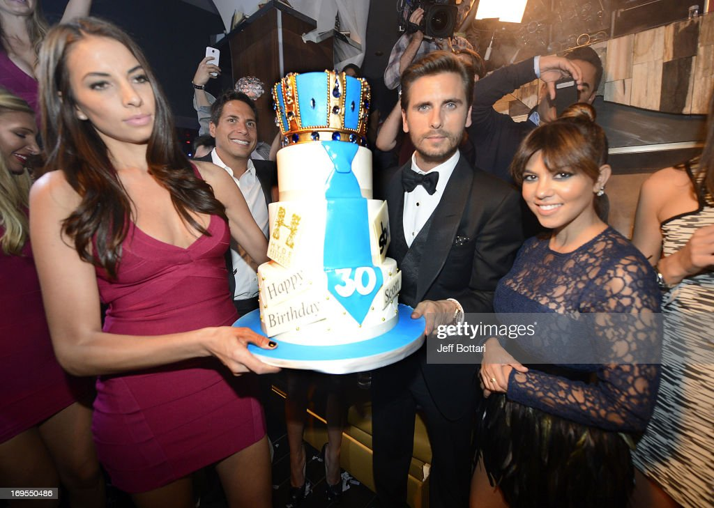 Television personalities <a gi-track='captionPersonalityLinkClicked' href=/galleries/search?phrase=Scott+Disick&family=editorial&specificpeople=4420046 ng-click='$event.stopPropagation()'>Scott Disick</a> (L) and <a gi-track='captionPersonalityLinkClicked' href=/galleries/search?phrase=Kourtney+Kardashian&family=editorial&specificpeople=3955024 ng-click='$event.stopPropagation()'>Kourtney Kardashian</a> pose with his birthday cake as they celebrate Scott's 30th birthday at Hyde Bellagio at the Bellagio over Memorial Day weekend on May 26, 2013 in Las Vegas, Nevada.
