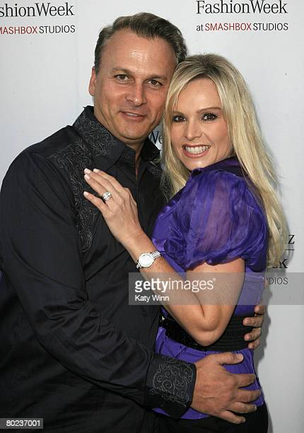 Television personalities Simon Barney and Tamra Barney attend MercedesBenz Fashion Week held at Smashbox Studios on March 13 2008 in Culver City...