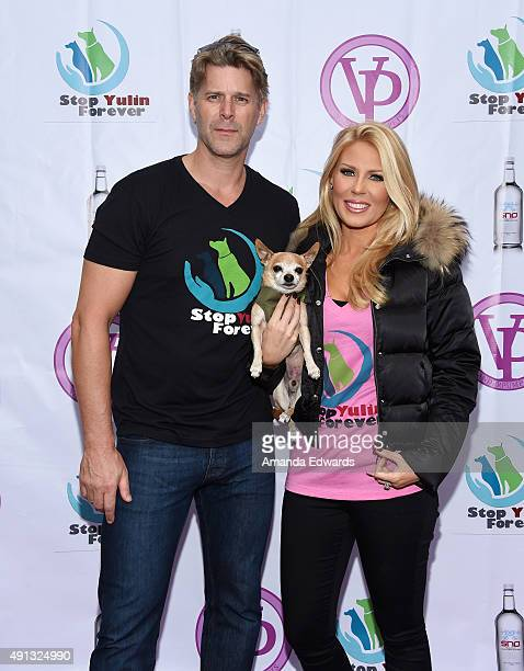 Television personalities Slade Smiley and Gretchen Rossi and their dog Remi attend the StopYulinForever March to End Dog Cruelty in Yulin China at...