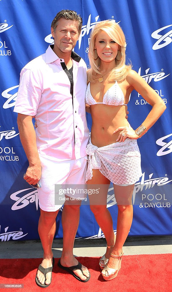 Television personalities Slade Smiley (L) and Gretchen Rossi arrive at the Sapphire Pool & Day Club grand opening party on May 4, 2013 in Las Vegas, Nevada.