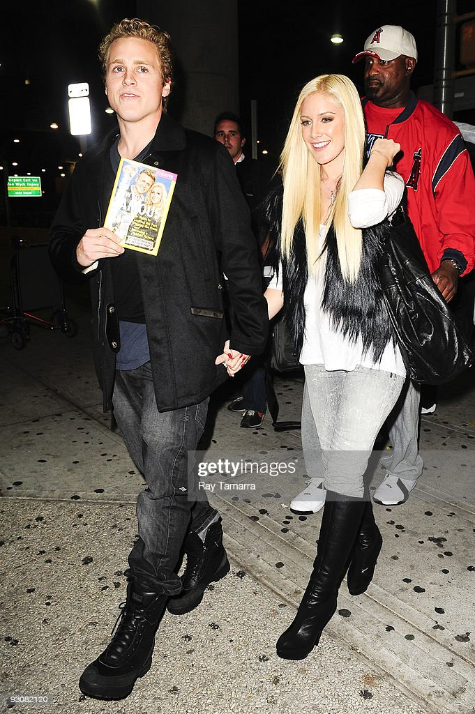 Television personalities Spencer Pratt (L) and Heidi Montag leave the John F. Kennedy International Airport on November 15, 2009 in New York City.
