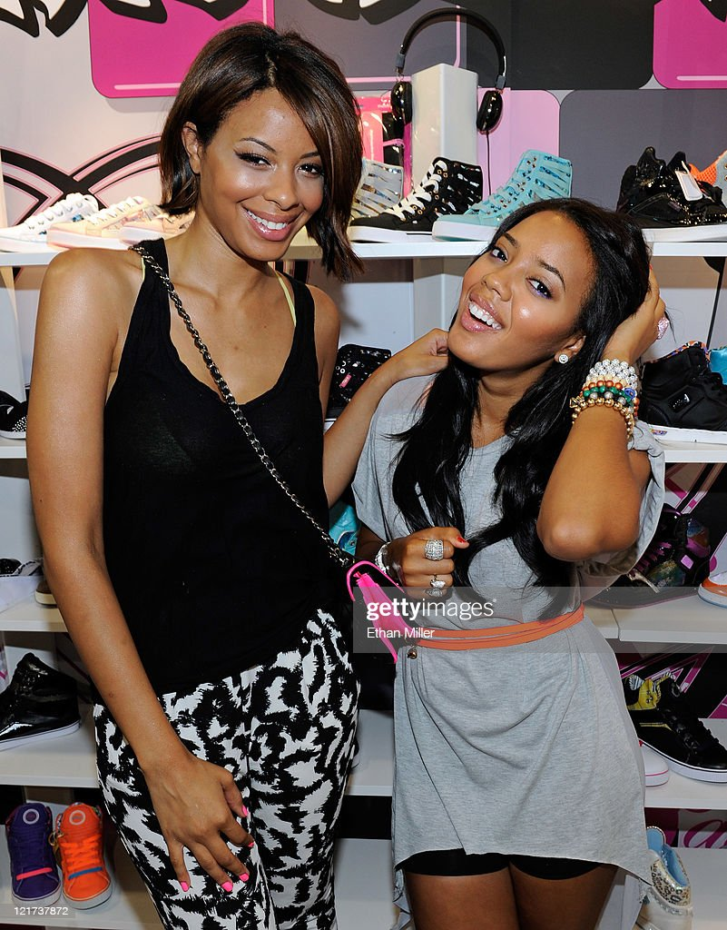 Television personalities Vanessa Simmons and Angela Simmons appear at the Pastry booth at the MAGIC clothing industry convention at the Las Vegas...