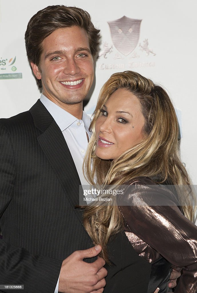 Television personality Adrienne Maloof (r) and boyfriend Jacob Busch arrive at Mark Kearney Group - 'Iced Out' Luxury Emmy Suite - Inside - Day 1 on September 19, 2013 in Los Angeles, California.
