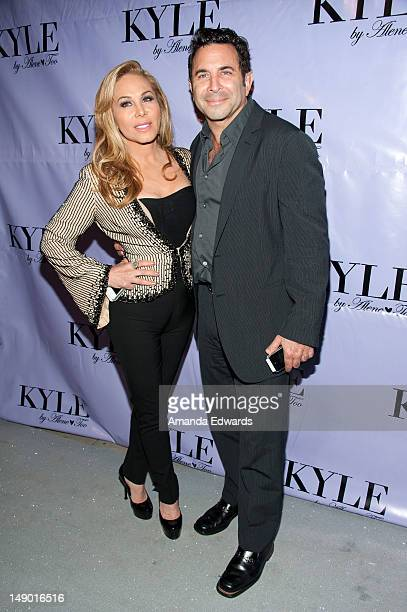 Television personality Adrienne Maloof and her husband Dr Paul Nassif arrive at the grand opening of Kyle Richards' new boutique 'Kyle By Alene Too'...