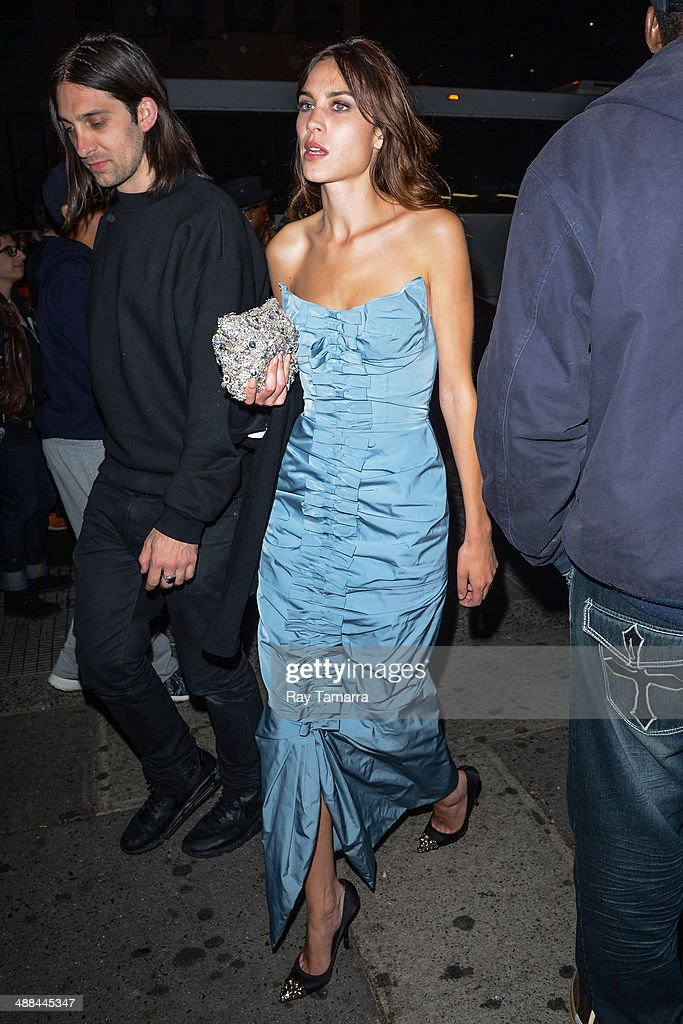 Television personality Alexa Chung enters the 'Charles James: Beyond Fashion' Costume Institute Gala after party at Up & Down on May 5, 2014 in New York City.