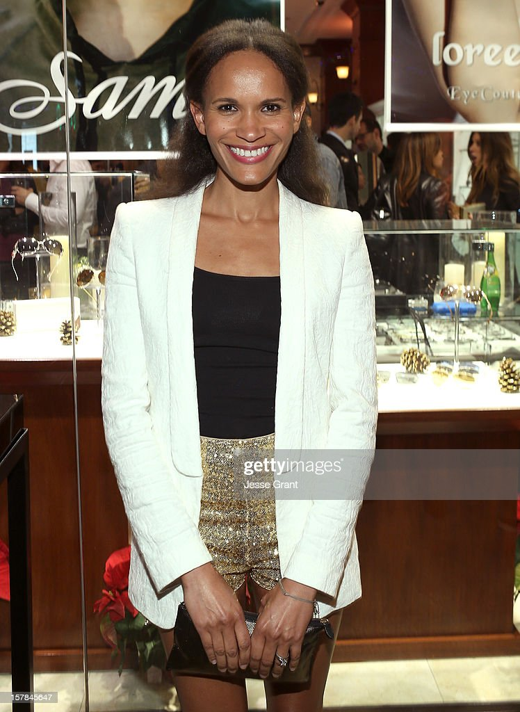 Television personality Amanda Luttrell Garrigus attends the Grand Opening of The Eye Gallery In Los Angeles on December 6, 2012 in Los Angeles, California.