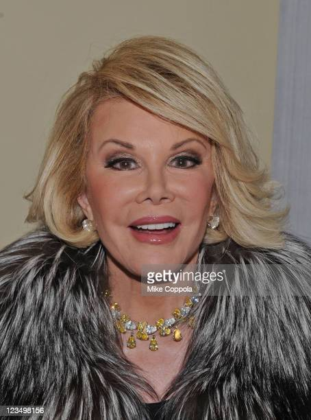 Television personality and actress Joan Rivers shows poses for a picture on location for the filming of her reality show 'Joan Melissa Joan Knows...