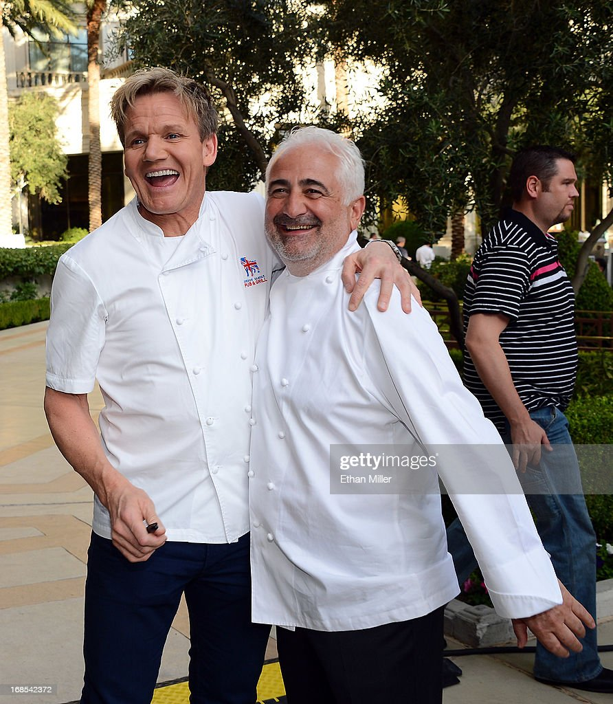 Television personality and chef <a gi-track='captionPersonalityLinkClicked' href=/galleries/search?phrase=Gordon+Ramsay&family=editorial&specificpeople=210520 ng-click='$event.stopPropagation()'>Gordon Ramsay</a> (L) and chef Guy Savoy appear at Vegas Uncork'd by Bon Appetit's Grand Tasting event at Caesars Palace on May 10, 2013 in Las Vegas, Nevada.