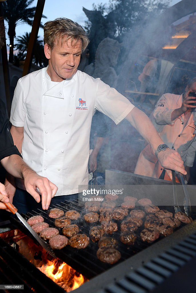 Television personality and chef <a gi-track='captionPersonalityLinkClicked' href=/galleries/search?phrase=Gordon+Ramsay&family=editorial&specificpeople=210520 ng-click='$event.stopPropagation()'>Gordon Ramsay</a> cooks at his <a gi-track='captionPersonalityLinkClicked' href=/galleries/search?phrase=Gordon+Ramsay&family=editorial&specificpeople=210520 ng-click='$event.stopPropagation()'>Gordon Ramsay</a> BurGR booth at Vegas Uncork'd by Bon Appetit's Grand Tasting event at Caesars Palace on May 10, 2013 in Las Vegas, Nevada.