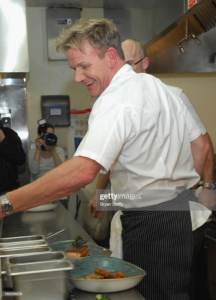 Television personality and chef <a gi-track='captionPersonalityLinkClicked' href=/galleries/search?phrase=Gordon+Ramsay&family=editorial&specificpeople=210520 ng-click='$event.stopPropagation()'>Gordon Ramsay</a> cooks during a traditional Sunday Roast at <a gi-track='captionPersonalityLinkClicked' href=/galleries/search?phrase=Gordon+Ramsay&family=editorial&specificpeople=210520 ng-click='$event.stopPropagation()'>Gordon Ramsay</a> Pub & Grill at Caesars Palace in celebration of the opening of the restaurant as well as <a gi-track='captionPersonalityLinkClicked' href=/galleries/search?phrase=Gordon+Ramsay&family=editorial&specificpeople=210520 ng-click='$event.stopPropagation()'>Gordon Ramsay</a> BurGR at Planet Hollywood Resort & Casino on January 27, 2013 in Las Vegas, Nevada.
