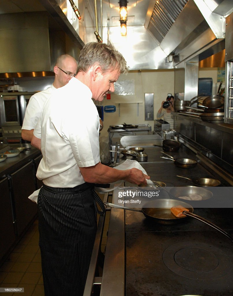 Television personality and chef Gordon Ramsay cooks during a traditional Sunday Roast at Gordon Ramsay Pub & Grill at Caesars Palace in celebration of the opening of the restaurant as well as Gordon Ramsay BurGR at Planet Hollywood Resort & Casino on January 27, 2013 in Las Vegas, Nevada.