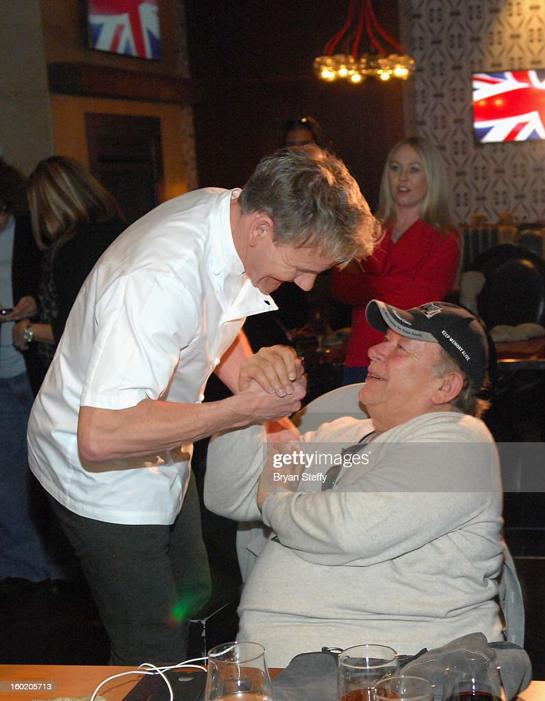 Television personality and chef Gordon Ramsay (L) greets television host and writer Robin Leach during a traditional Sunday Roast at Gordon Ramsay Pub & Grill at Caesars Palace in celebration of the opening of the restaurant as well as Gordon Ramsay BurGR at Planet Hollywood Resort & Casino on January 27, 2013 in Las Vegas, Nevada.
