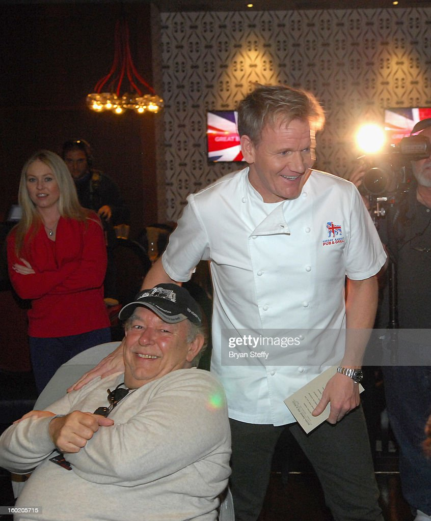Television personality and chef Gordon Ramsay (R) greets television host and writer Robin Leach during a traditional Sunday Roast at Gordon Ramsay Pub & Grill at Caesars Palace in celebration of the opening of the restaurant as well as Gordon Ramsay BurGR at Planet Hollywood Resort & Casino on January 27, 2013 in Las Vegas, Nevada.