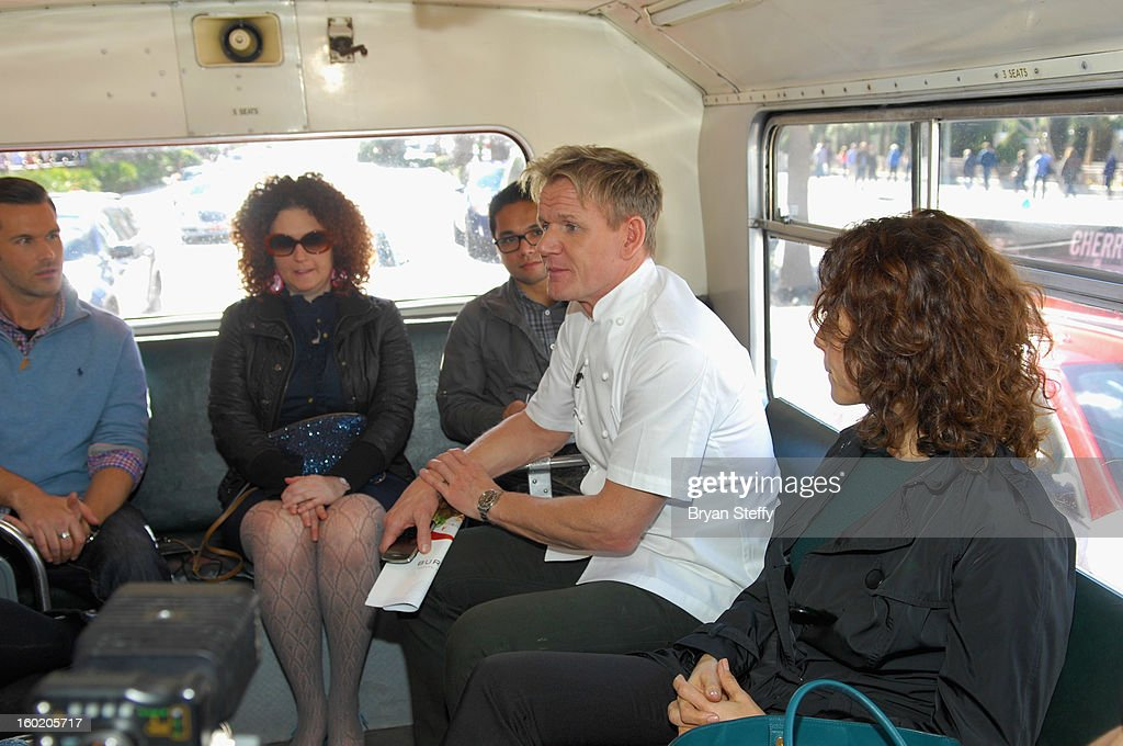 Television personality and chef Gordon Ramsay (C) rides a double-decker bus with guests during a traditional Sunday Roast at Gordon Ramsay Pub & Grill at Caesars Palace in celebration of the opening of the restaurant as well as Gordon Ramsay BurGR at Planet Hollywood Resort & Casino on January 27, 2013 in Las Vegas, Nevada.