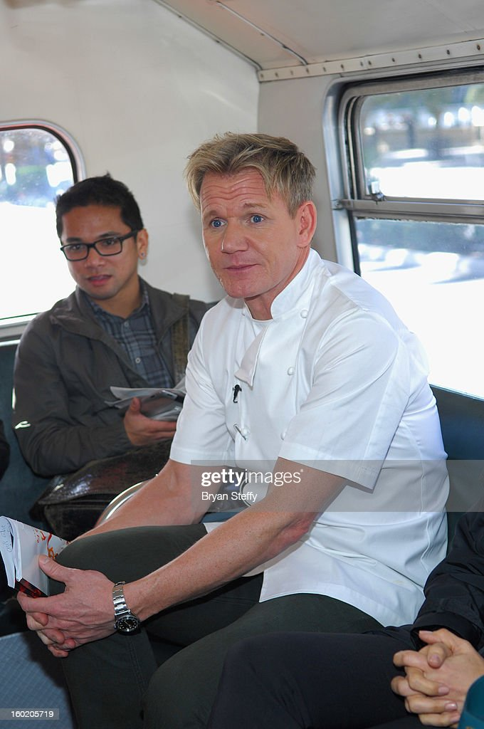 Television personality and chef Gordon Ramsay (R) rides a double-decker bus with guests during a traditional Sunday Roast at Gordon Ramsay Pub & Grill at Caesars Palace in celebration of the opening of the restaurant as well as Gordon Ramsay BurGR at Planet Hollywood Resort & Casino on January 27, 2013 in Las Vegas, Nevada.