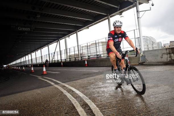 Television personality and chef Gordon Ramsay takes part in the cycle stage during the AJ Bell London Triathlon 2017 at Royal Victoria Docks on July...