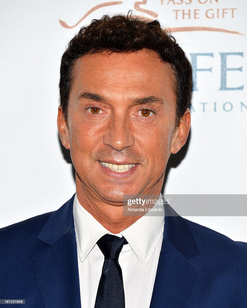 Television personality and choreographer <a gi-track='captionPersonalityLinkClicked' href=/galleries/search?phrase=Bruno+Tonioli&family=editorial&specificpeople=742704 ng-click='$event.stopPropagation()'>Bruno Tonioli</a> arrives at the 2nd Annual Beyond Hunger: A Place At The Table Benefit Honoring Susan Sarandon at Montage Beverly Hills on September 19, 2013 in Beverly Hills, California.