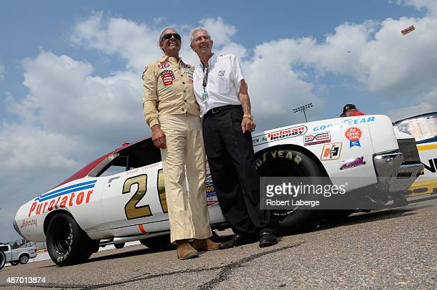 Television personality and fomer NASCAR driver Kyle Petty left poses with NASCAR Hall of Famer Leonard Wood and the Wood Brothers Racing 1972 Mercury...