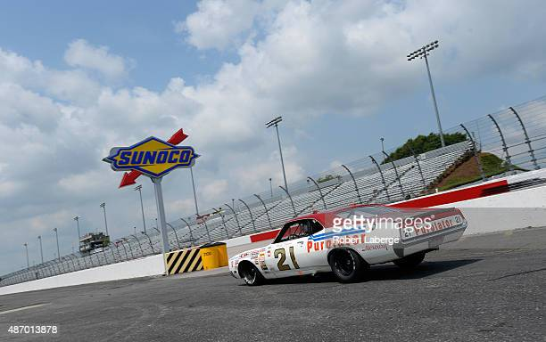 Television personality and former NASCAR driver Kyle Petty drives an exhibition run in the 1972 Wood Brothers Racing Mercury prior to qualifying for...
